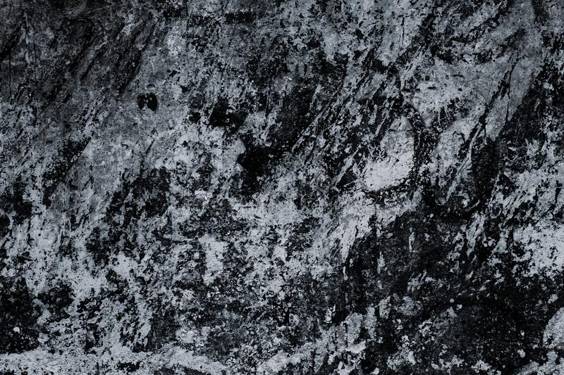 Black and white marble surface, texture. Abstract background, pattern. Dark tile close-up, great design. Old dirty stone wall. Gru stock photography