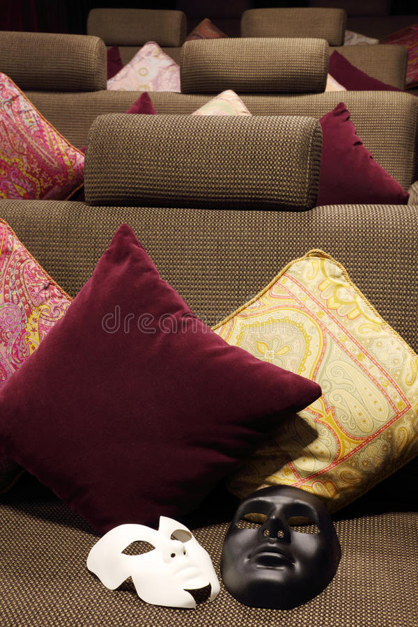 Download Black And White Masks Are On Soft Sofa Stock Photo - Image: 33337196