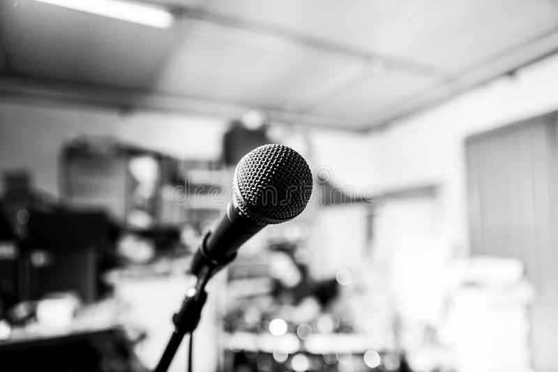 Black and white microphone on a band rehearsal garage. High contrast black and white close up of a microphone on a band rehearsal place with a very shallow depth royalty free stock photo