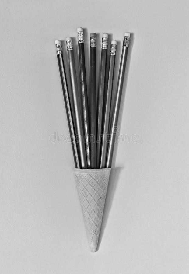 Black and white. minimalism. Ice cream cone, art, colorful pencils,fun, business concept. top view. copy space royalty free stock image