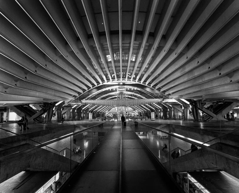 Black and white. The modern architecture of the Portuguese station Oriente in the city of Lisbon. Structures made of glass and con royalty free stock images
