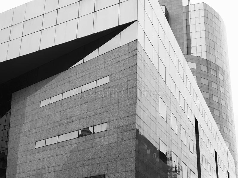 Black and white modern glass detail building. Black and white photo photography of modern skyscraper glass building detail close up closeup royalty free stock photos