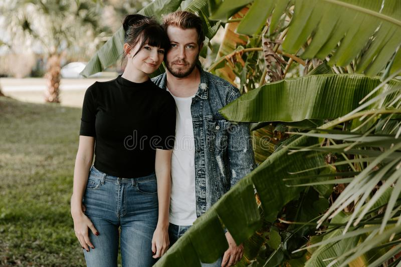 Portrait of Two Cute Modern Caucasian Beautiful Young Adult Guy Boyfriend Lady Girlfriend Couple Hugging and Kissing in Love in Na royalty free stock photo