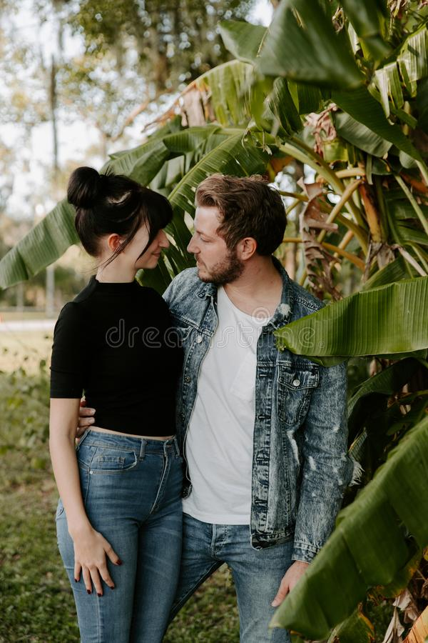 Portrait of Two Cute Modern Caucasian Beautiful Young Adult Guy Boyfriend Lady Girlfriend Couple Hugging and Kissing in Love in Na stock images