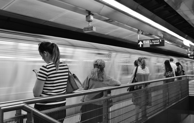 Black and White New York City Subway Car Arriving Train Station People Waiting royalty free stock image