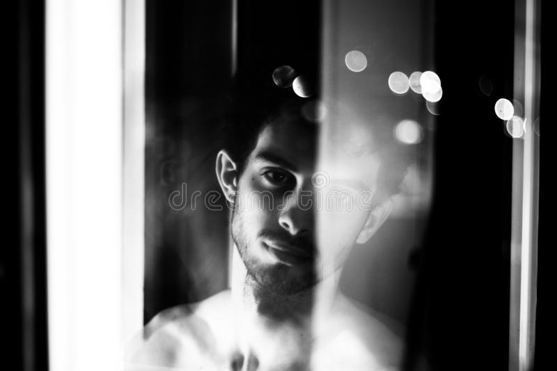 Black and white night young man portrait royalty free stock photos