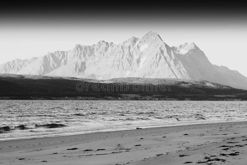 Black and white Norway seashore mountain landscape background stock photography