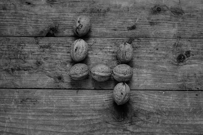 Black and white Number 4 from walnuts. Black and white of top view of english alphabet made from walnuts on a wooden table. Number 4 stock photos