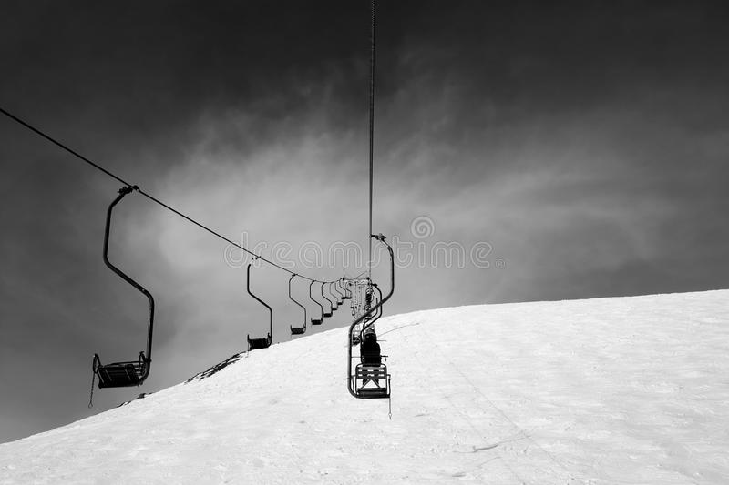 Black and white old chair-lift in ski resort. Caucasus Mountains, Elbrus region, mount Cheget stock images