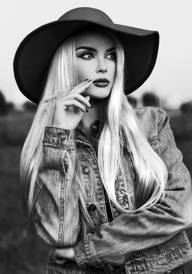 Black and white outdoor portrait of a beautiful country girl stock image