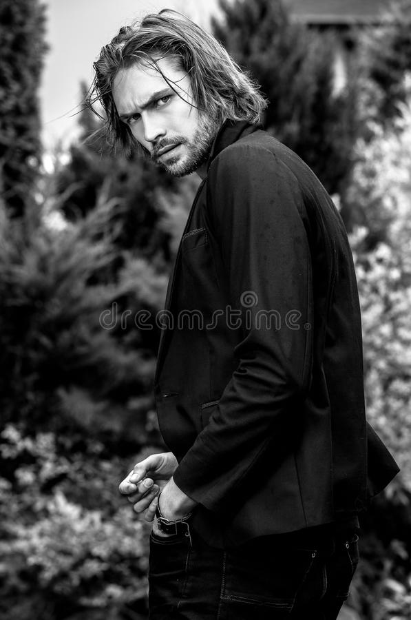 Download black white outdoor portrait of elegant long hair handsome man stock photo image