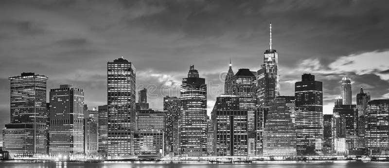 Manhattan panoramic skyline at night, New York. Black and white panoramic picture of Manhattan skyline at night, New York City, USA stock image