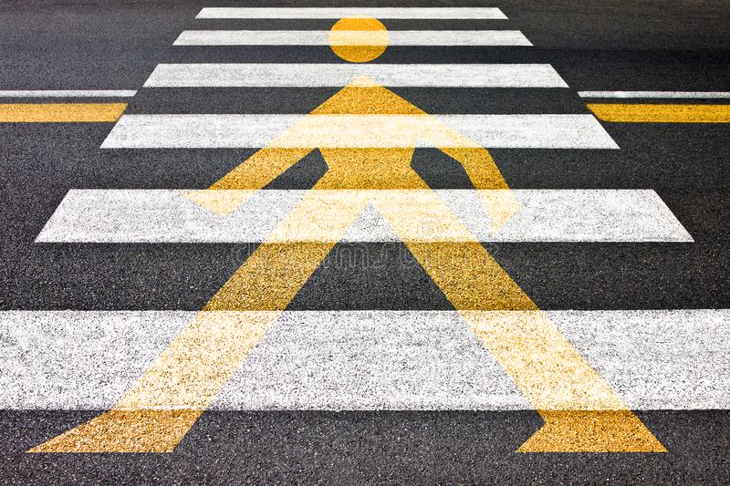 Black and white pedestrian crossing with silhouette of man on it.  stock photography