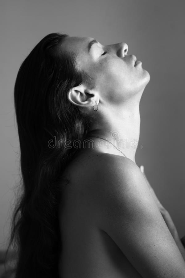 Black and white photo brunette in profile royalty free stock image