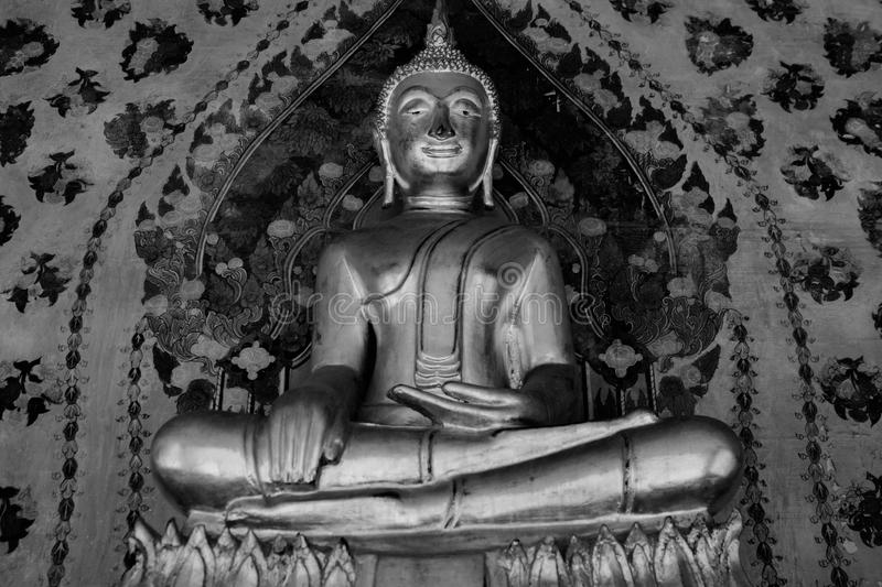 Black and White photo .Buddha gold and thai art architecture in Wat Arun buddhist temple in Bangkok, Thailand. Buddha gold and thai art architecture in Wat Arun royalty free stock photography