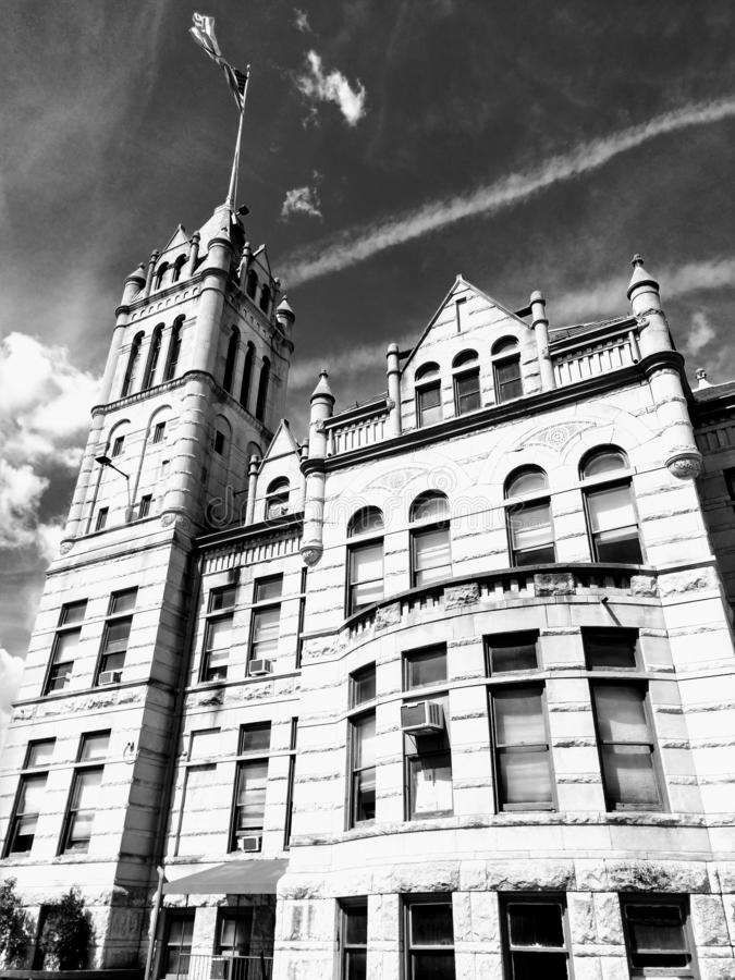 Black and white photo building police station sky stock images