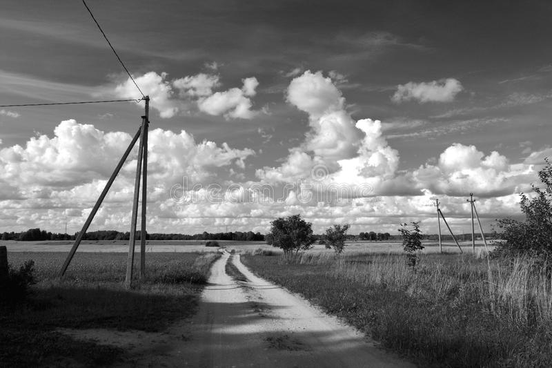 Black and white photo of countryside landscape. Black and white photo of summer countryside landscape with clouds and road stock photography