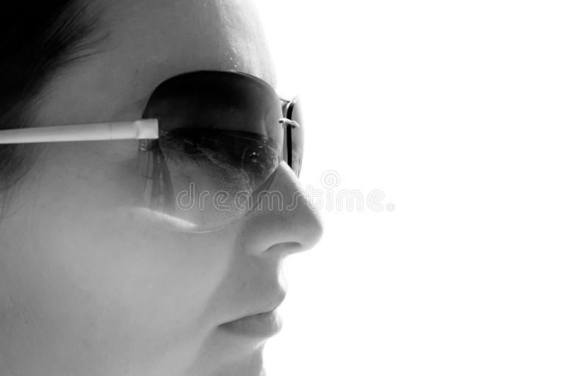 Black and white photo of a girl in profile in sunglasses copyspace stock image
