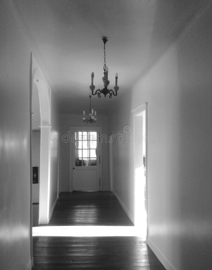 Black and White photo of Hallway in shadows stock image