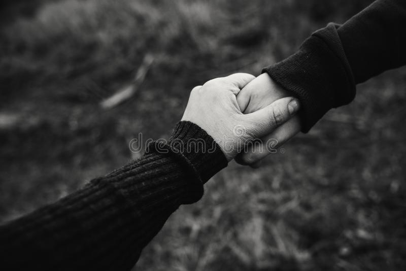 Black and White Photo of Holding Hands royalty free stock photo