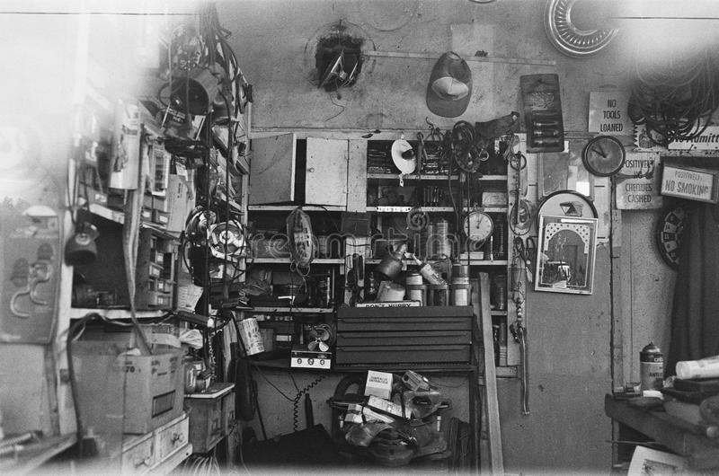 Black and white photo of interior of an old garage royalty free stock images