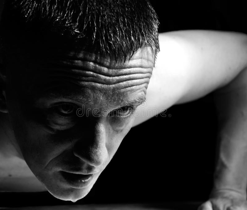 Black and white photo man push ups from the floor in sports. Black and white photo a man push ups from the floor in sports stock image
