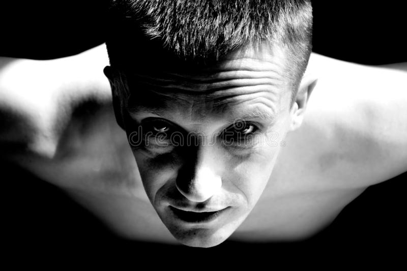 Black and white photo man push ups from the floor in sports. Black and white photo a man push ups from the floor in sports stock photography