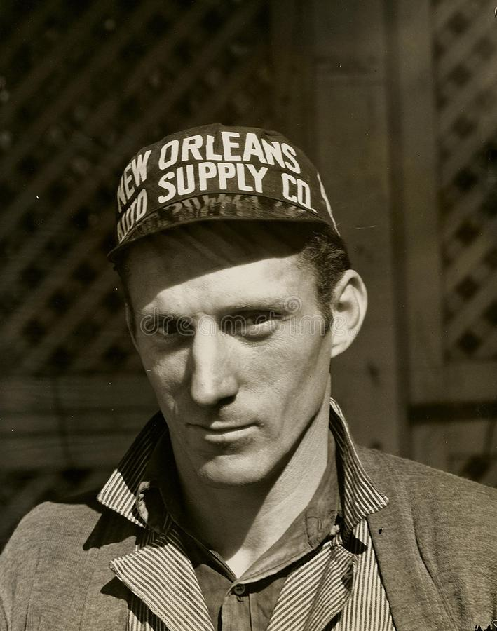 Black And White Photo Of Man Wearing New Orleans Supply Hat Free Public Domain Cc0 Image