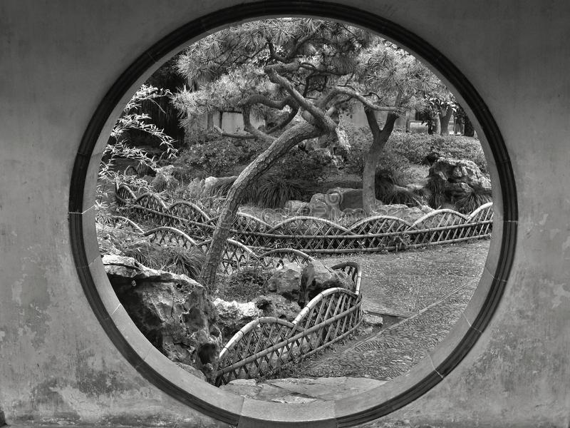 SUZHOU, JIANGSU PROVINCE CHINA, MAY 2015: Moon gate in the Humble administrator garden. Black and white photo of the Moon gate in the Humble administrator garden royalty free stock image