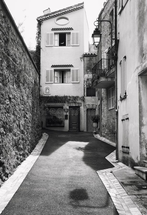 Black and white photo of a narrow street in the old center of C stock images