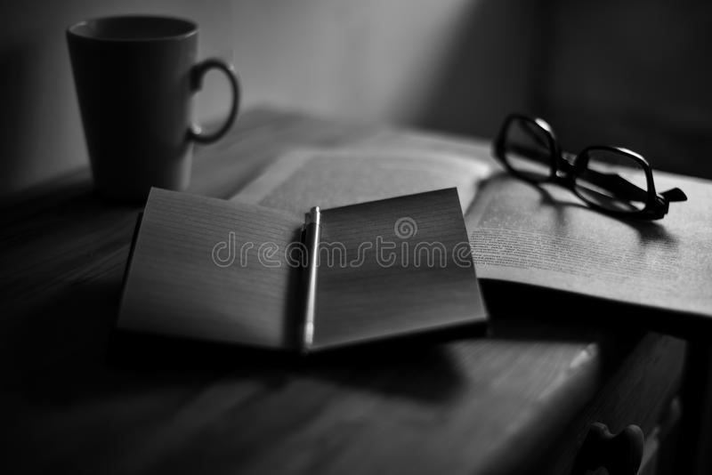 Notebook with a pen on the table royalty free stock images