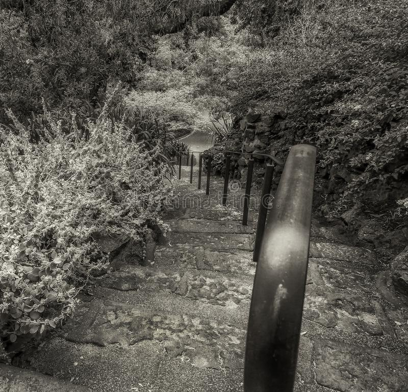 Old stairs and iron handrail royalty free stock photos