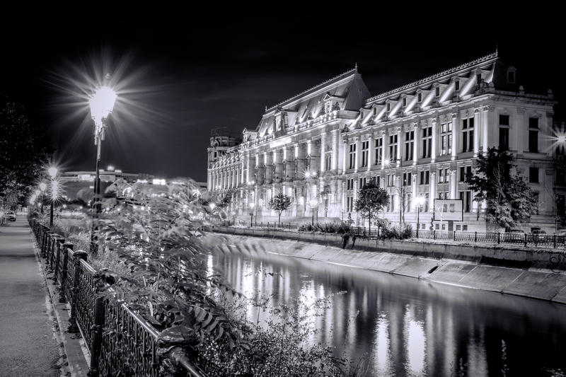 Black and White photo of The Palace of Justice at night, near Dambovita river. stock photos