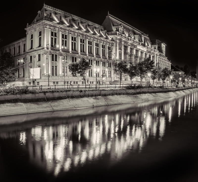 Black and White photo of The Palace of Justice at night, near Dambovita river. stock photography