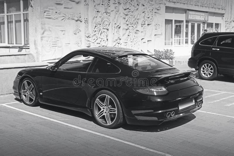 Kiev, Ukraine - June 8, 2017: Black and white photo. Porsche 911 Turbo in private parking lot. Black and white photo. Porsche 911 Turbo in private parking lot stock image