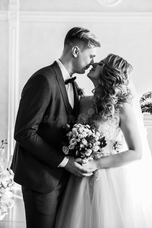 Black and white photo. portrait of a happy bride and groom. royalty free stock image