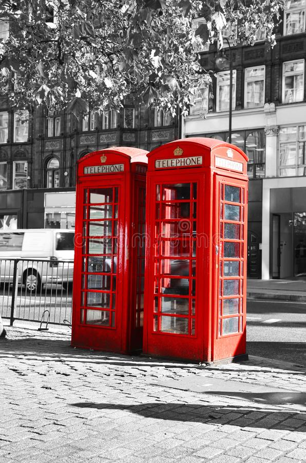 Black and white photo with red telephone booth at London city. United Kingdom stock photos