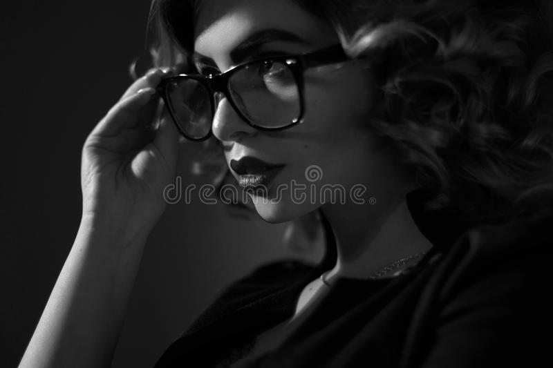 Black and white photo of young secretary in glasses and cur stock photos