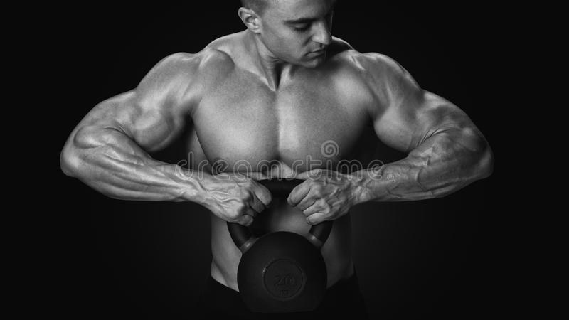 Black and white photo of shirtless young athlete with muscular b royalty free stock photos