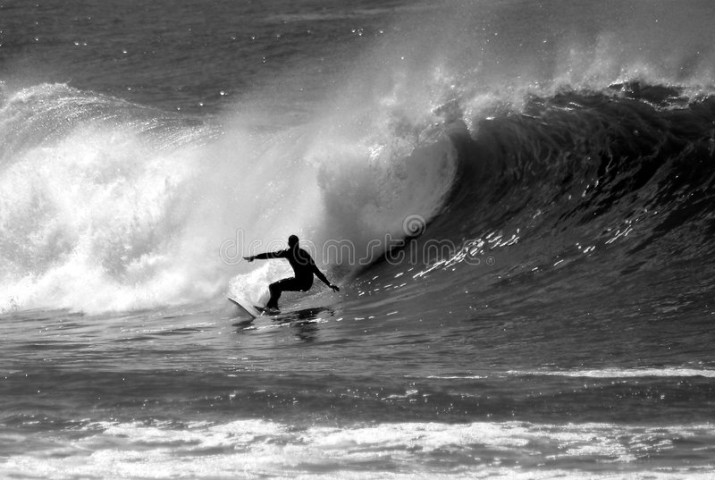 Black and White Photo of a Surfer Surfing stock images
