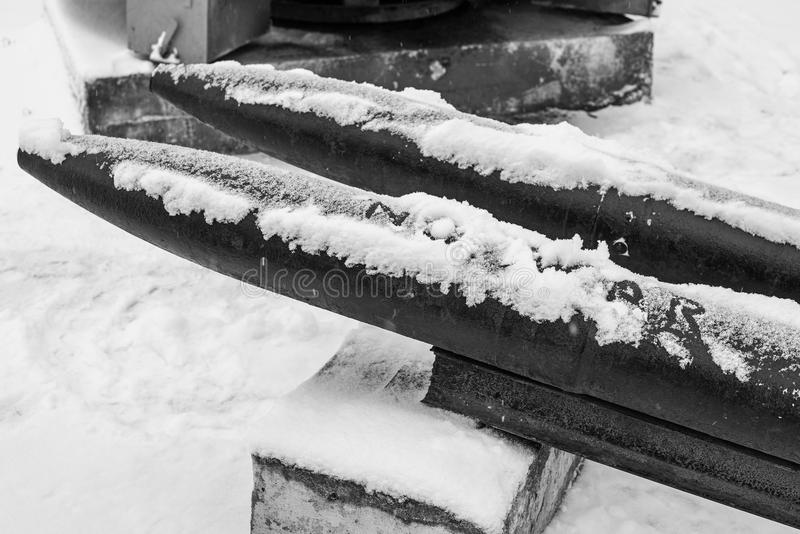 Black and white photo torpedoes in the snow with the inscription no war. Black and white torpedoes in the snow with the inscription no war royalty free stock photo