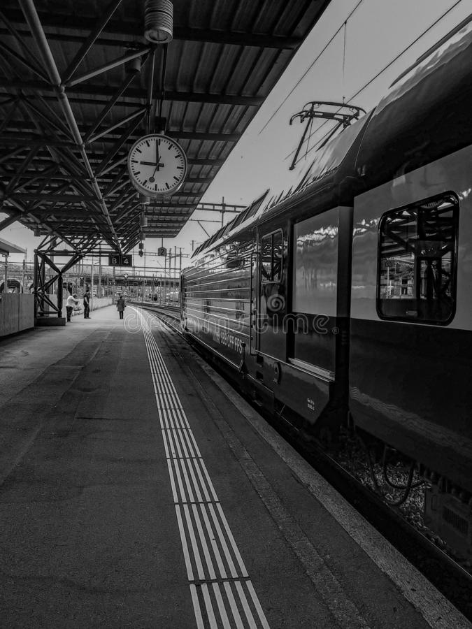 Black and White photo of train and people royalty free stock images