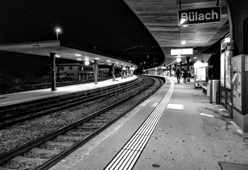 Black and white photo of train station at night stock photo