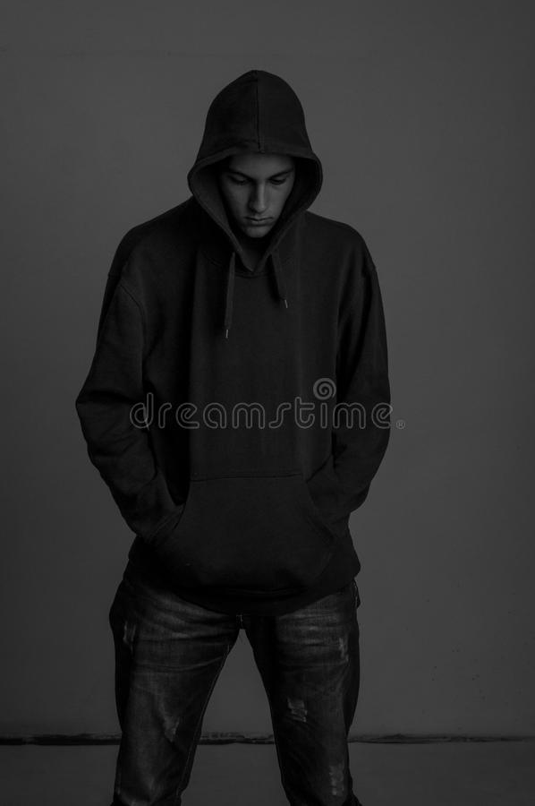 Download Black And White Photo Of Upsed Teenager With Hoodie Looking Down Again Stock Image - Image: 32685329