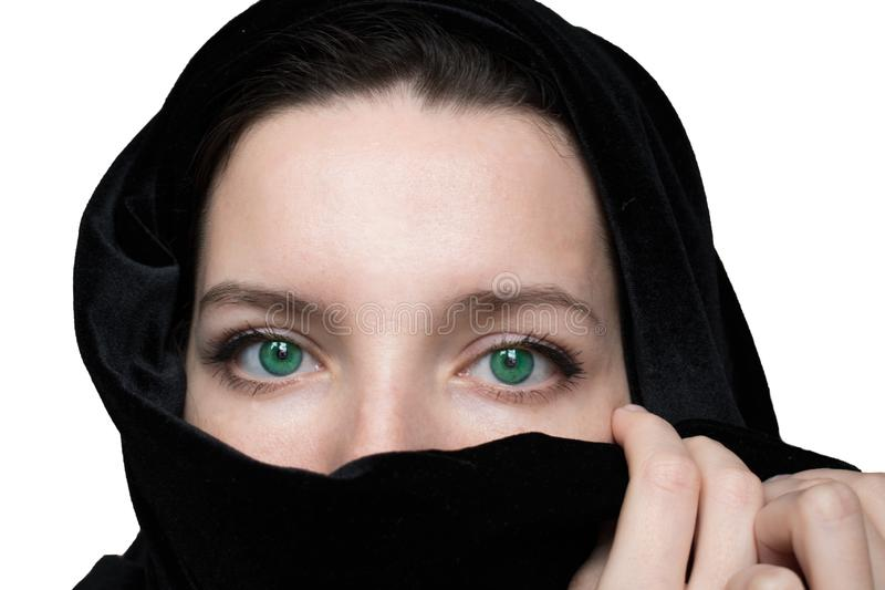 Black and white photo of a woman`s face with green eyes royalty free stock photos