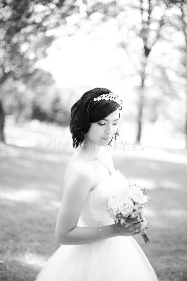 Black and white photo.young bride in a luxurious dress stock photography