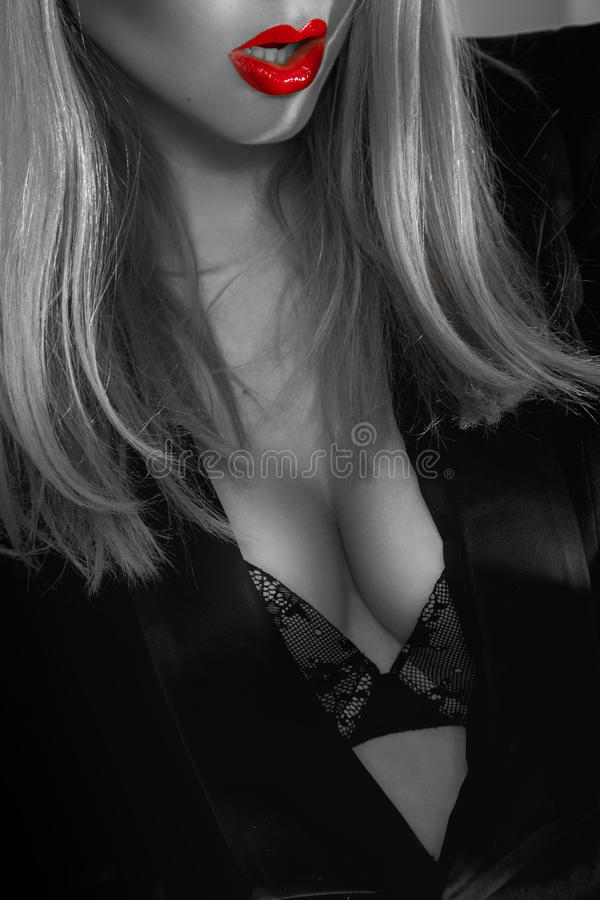 Black and white photograph of busty secretary with red lips royalty free stock images