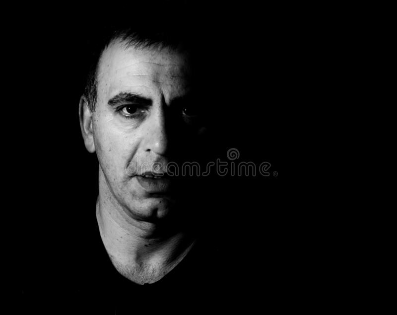 Black and white photograph of man, portrait. Black and white photograph of man, portrait normal person people man`s life stock photos