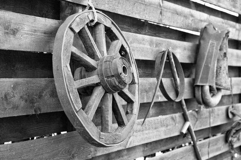 Black and white photograph of an old wheel. From a village cart stock photos