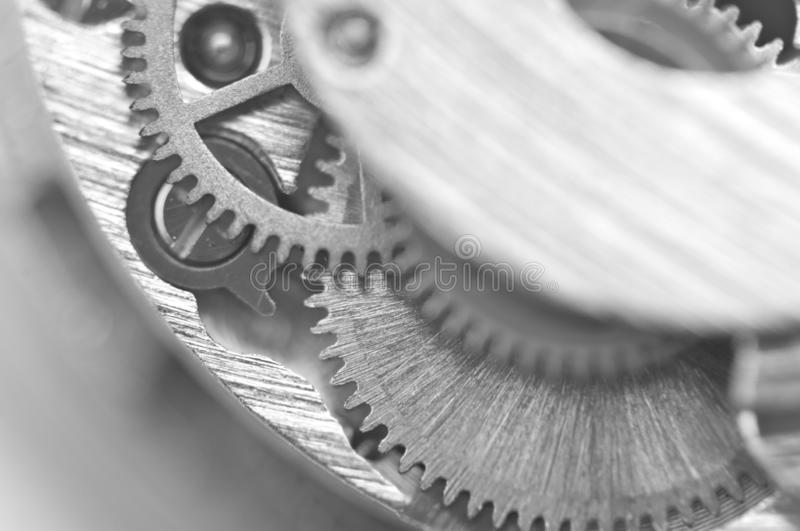 Black and white photography. Background with metal gear wheels. Macro. Black and white photography. Background with metal gear wheels. Conceptual photo for royalty free stock photos